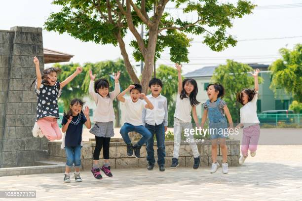 group of school friends outdoors - childhood stock pictures, royalty-free photos & images