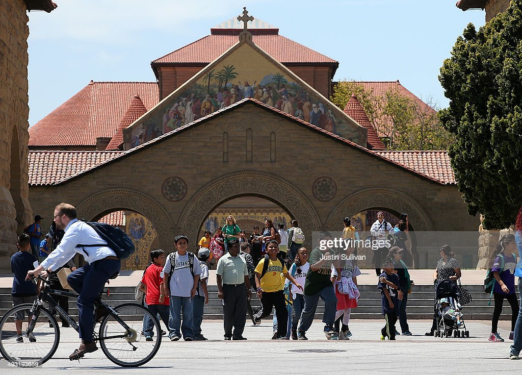 A group of school kids tours the Stanford University campus on May 22, 2014 in Stanford, California. According to the Academic Ranking of World Universities by China's Shanghai Jiao Tong University, Stanford University ranked second behind Harvard University as the top universities in the world. UC Berkeley ranked third.