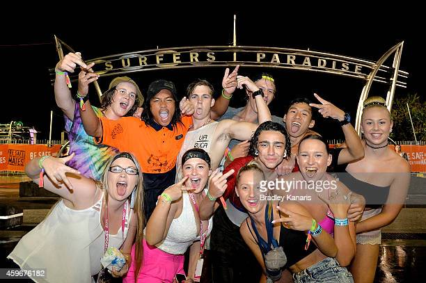 A group of school leavers pose for a photo during Australian 'schoolies' celebrations following the end of the year 12 exams on November 28 2014 in...