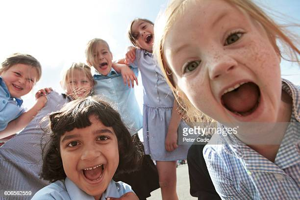 group of school primary children - medium group of people stock pictures, royalty-free photos & images