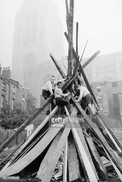 A group of schoolboys seen here adding the final touches to their bonfire in the shadow of the Anglican cathedral in St James Liverpool Circa...