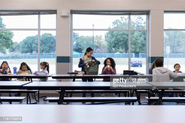 group of schoolchildren eating lunch - canteen stock pictures, royalty-free photos & images