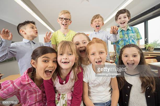 group of schoolchildren having fun in classroom, munich, bavaria, germany - kurdish girl stock photos and pictures