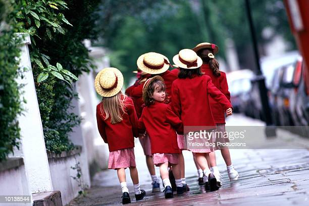 group of schoolgirls (5-7) - straw boater hat stock pictures, royalty-free photos & images