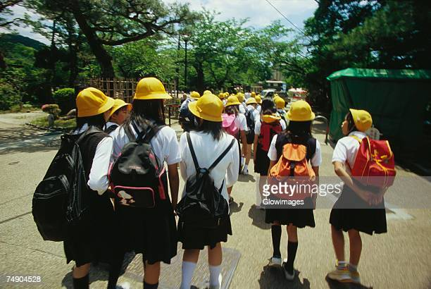 Group of schoolgirls walking on the road, Kyoto Prefecture, Japan