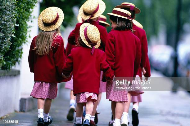 a group of schoolgirls, walking - schuluniform stock-fotos und bilder