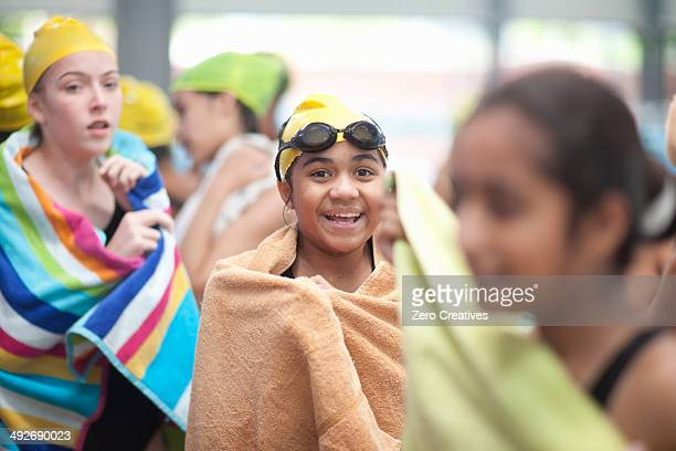 Group of schoolgirls wrapped in towels after swimming