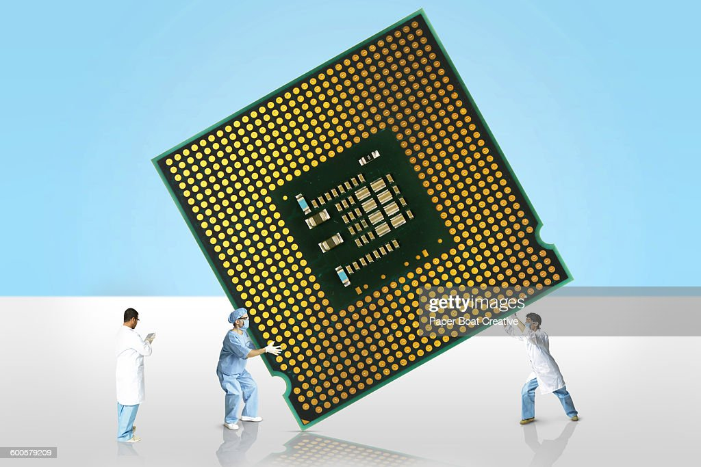 Group Of Scientists Carrying A Giant Microchip High-Res Stock Photo - Getty  Images