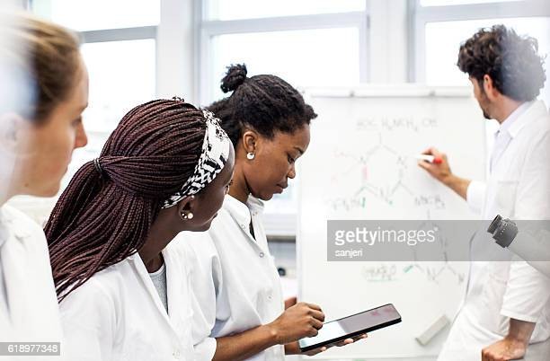 Group of Scientists Discussing New Findings on a Lab Meeting