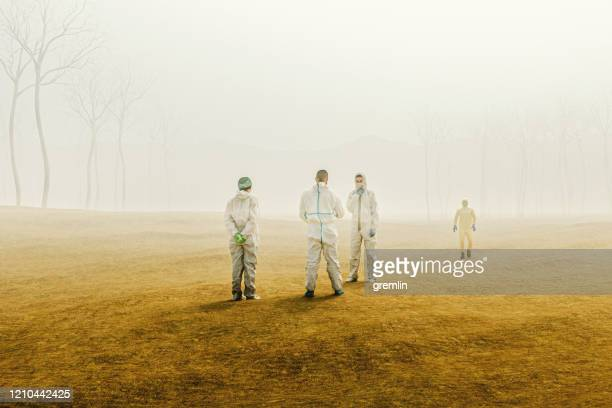 group of scientists in foggy desert - crash site stock pictures, royalty-free photos & images