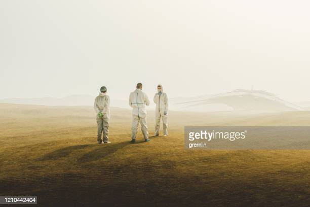 group of scientists with ufo in the desert - crash site stock pictures, royalty-free photos & images