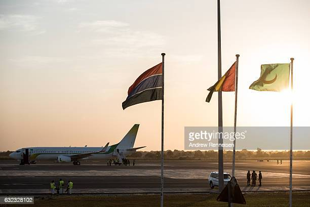 A group of security personnel gather on the tarmac before the departure of ExPresident Yahyah Jammeh on January 21 2017 at Banjul International...