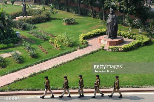 A group of security personnel patrols inside the premises of the Parliament during the winter session of Parliament on November 20 2019 in New Delhi...