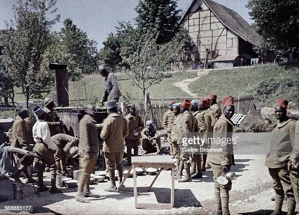 A group of Senegalese soldiers serving in the French Army as infantrymen is having lunch in SaintUlrich Department HautRhin Region Alsace 16th June...