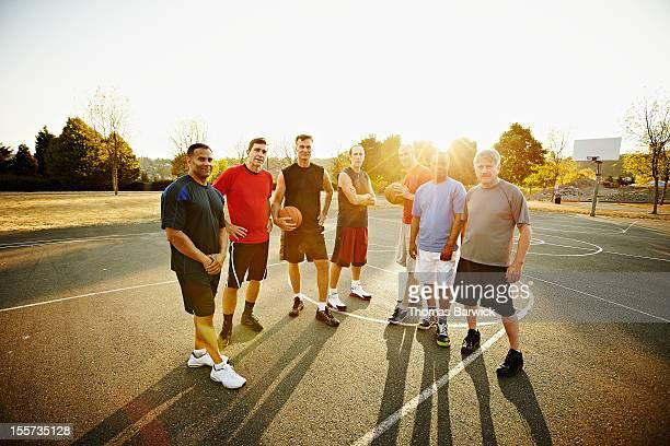 group of senior and mature basketball players - mittelgroße personengruppe stock-fotos und bilder