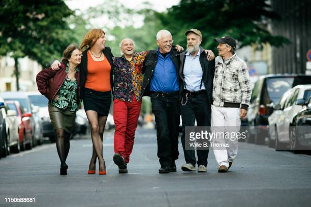 group of senior and middel age queer people - side by side stock pictures, royalty-free photos & images
