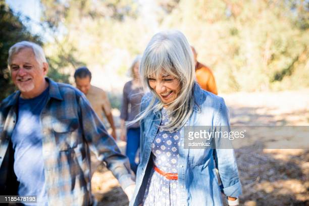group of senior friends exploring outdoors - active lifestyle stock pictures, royalty-free photos & images