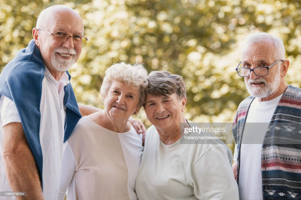 Group of senior friends smiling and having fun together at park : Stock Photo