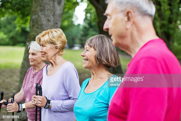 Group of senior people exercising in a park