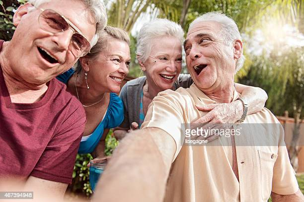 group of senior people taking selfie - naughty wife stock photos and pictures