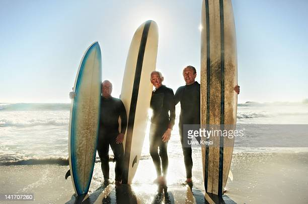 Group of senior surfers on beach