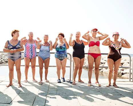 Group of senior women flexing their muscles - gettyimageskorea