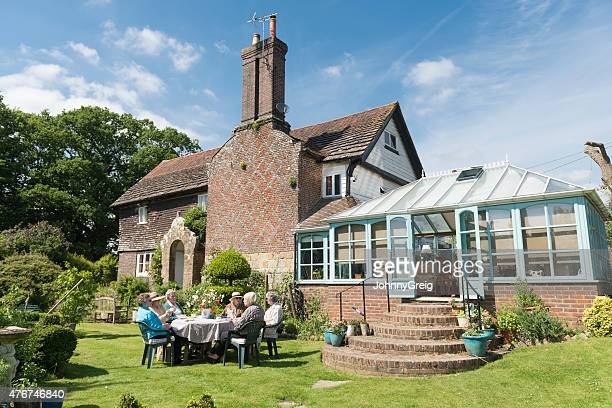 Group of senior women friends having afternoon tea alfresco