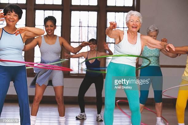 Group of senior women in hula hoop class