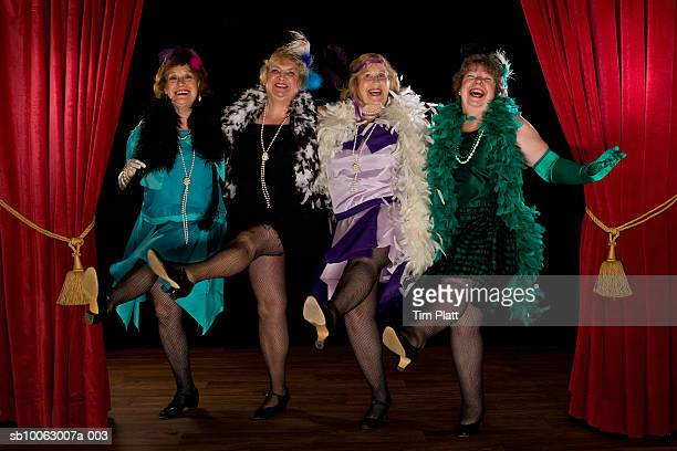 group of senior women performing on stage, laughing, portrait - old women in pantyhose stock photos and pictures