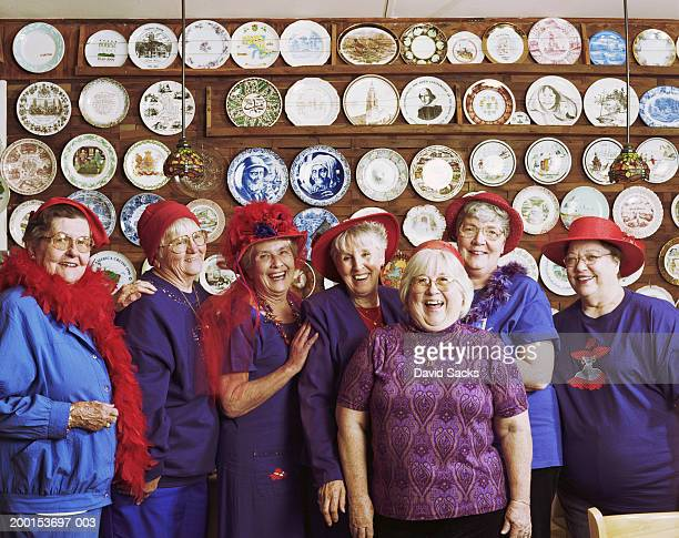 group of senior women smiling, portrait - purple hat stock pictures, royalty-free photos & images