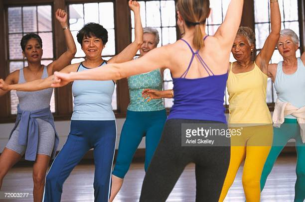 Group of senior women with instructor in exercise class
