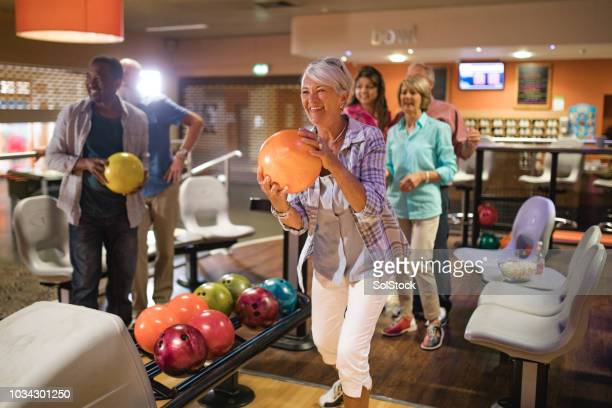 group of seniors bowling - 50 54 years stock pictures, royalty-free photos & images