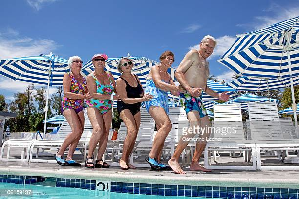 Group of seniors dancing by the pool