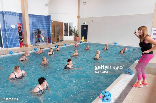 group of seniors doing water aerobics - lincolnshire stock pictures, royalty-free photos & images
