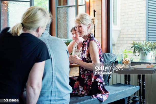 """group of seniors people sitting and talking. - """"martine doucet"""" or martinedoucet stock pictures, royalty-free photos & images"""