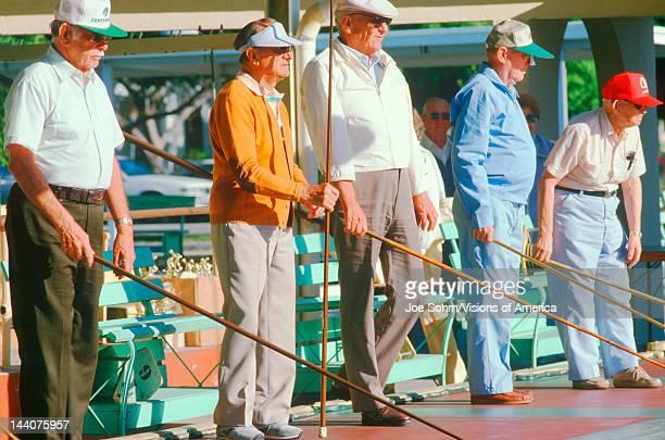 A group of seniors playing shuffleboard Mirror Lake St Petersburg FL