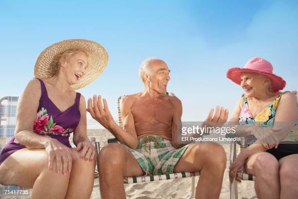 Group of seniors sitting in beach chairs