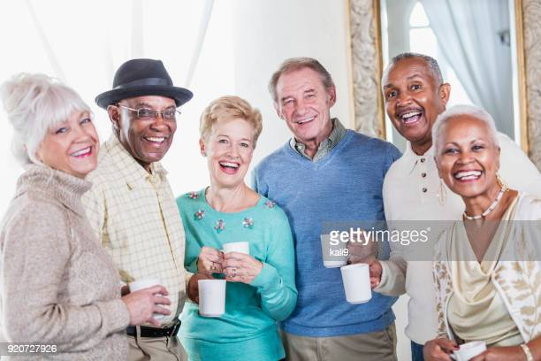 Group of seniors socializing over coffee