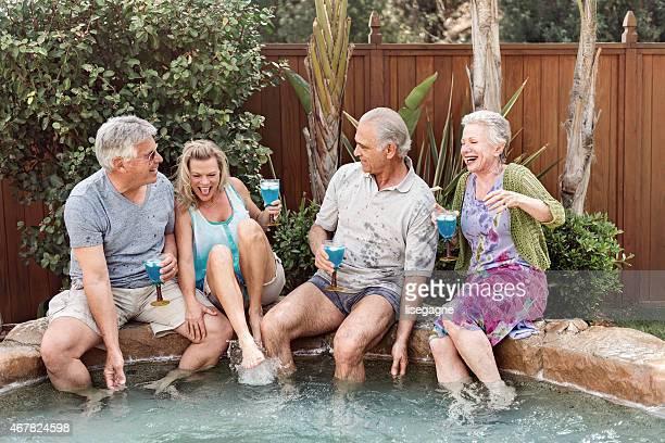 Group of seniors splashing in the hot tub