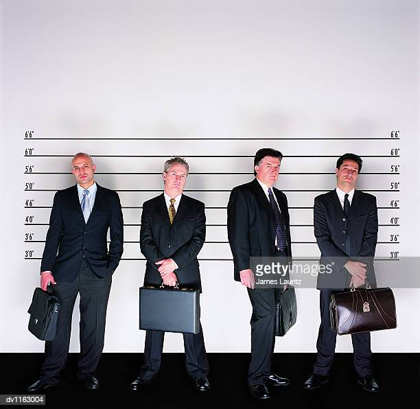 Group of Serious Businessmen Standing Holding Briefcases in a Police Line-up