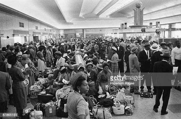 A group of seven hundred West Indian immigrants waiting in the Customs Hall at Southampton Docks after disembarkation 27th May 1956 Original...