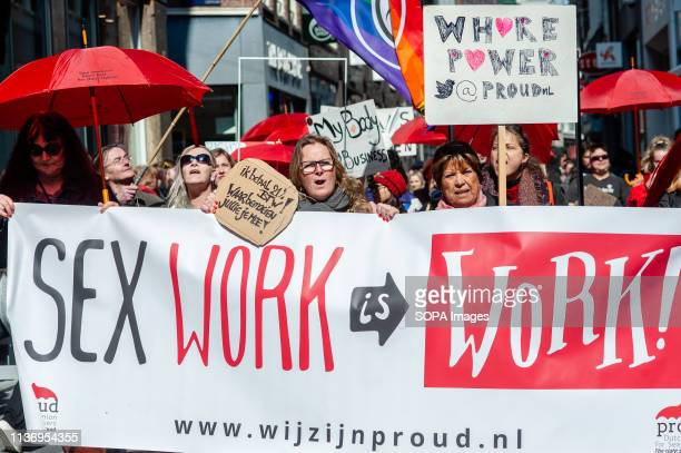 A group of sex workers and supporters are seen holding a banner during the demonstration After a social media campaign called 'I Am Priceless' to ban...