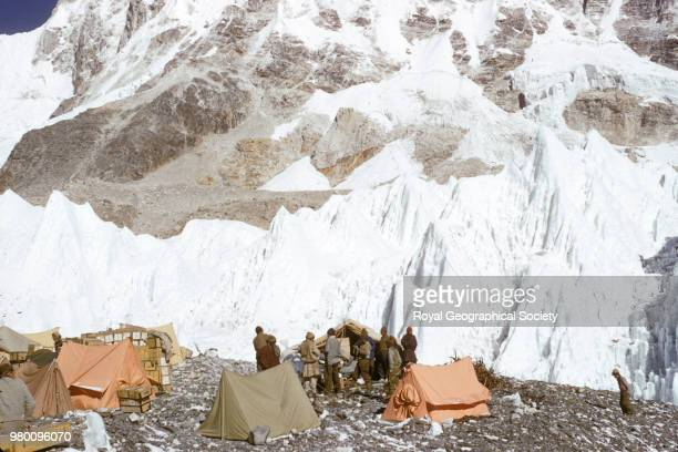 A group of Sherpas gather beside a tent at Base Camp Nepal March 1953 Mount Everest Expedition 1953