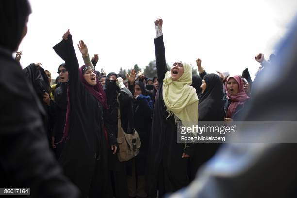 Group of Shia women supporting a new family law confront opponents of the law on April 15, 2009 in Kabul, Afghanistan. Opponents denounce the law as...