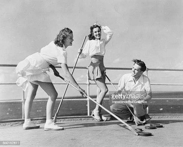 A group of shuffleboard players in action on a ship's deck Florida circa 1940
