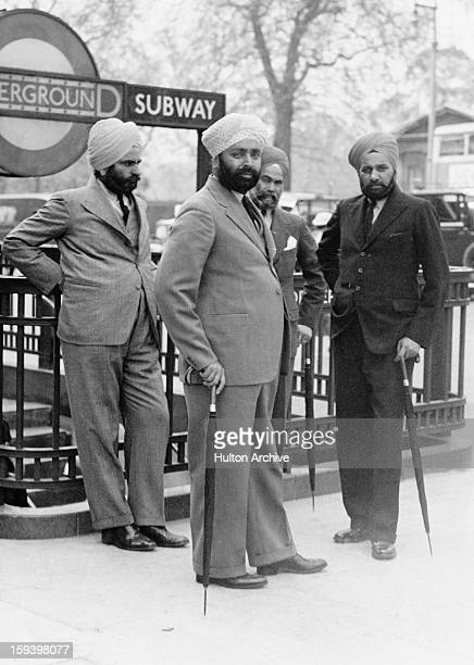 A group of Sikh men outside the entrance to Hyde Park Corner Underground station London circa 1935