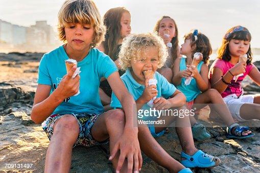 Kids Eating Ice Cream On Beach