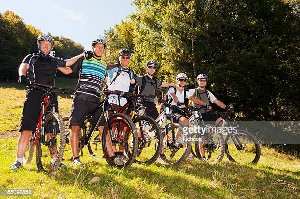 Group of six mountain bikers ready for downhill