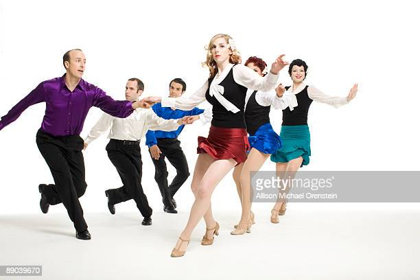 Group of six people swing dancing