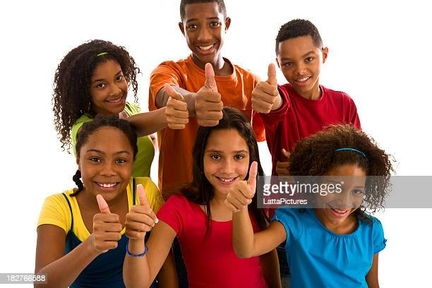 Group of six teenagers gesturing thumbs up